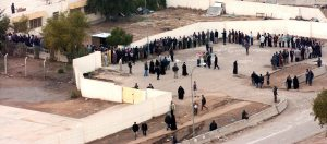 Iraqi voters wait in line to cast their vote at one of the polling sites in Baghdad, Iraq, Jan. 30, 2005
