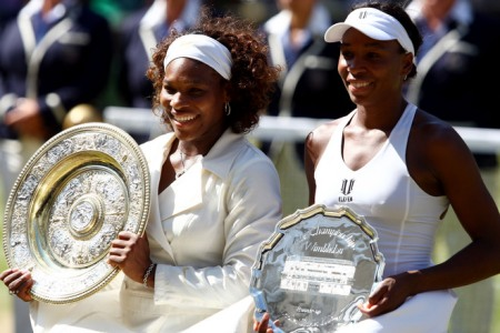 A victorious Serena Williams (L) stands alongside her sister Venus after the two battled for the Woman's Championship Crown at the Wimbledon Lawn Tennis Championships on July 4th, 2009.